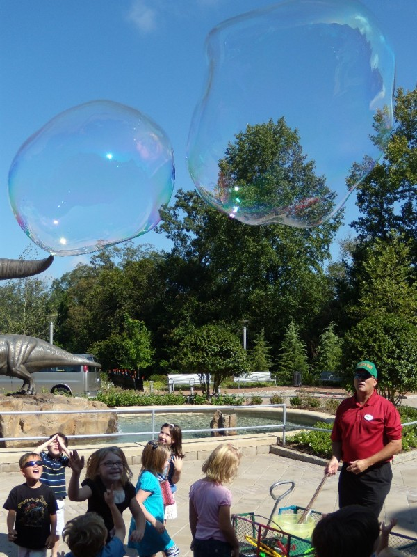 giant bubbles made from a string wand.
