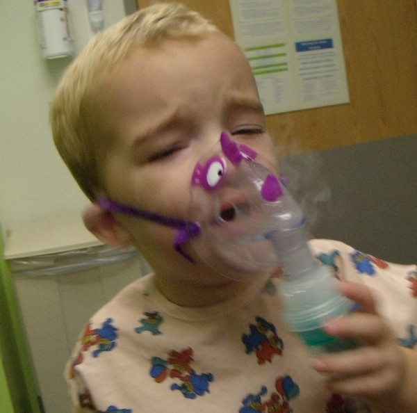 breathing treatment with his dinosaur